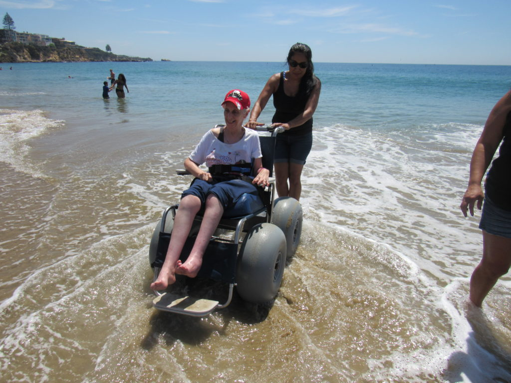 Linda in wheelchair in water